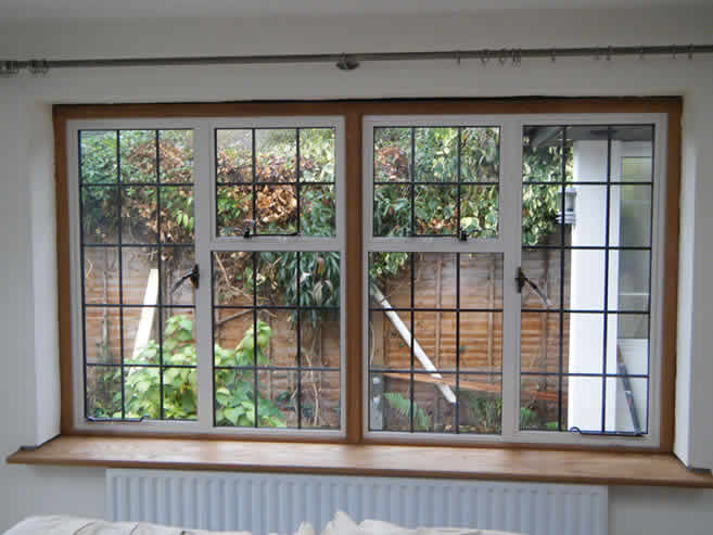 White leaded window into oak surrounds