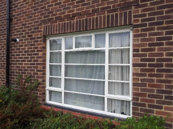 white metal frame windows