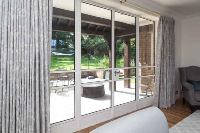 white metal windows, door and screens